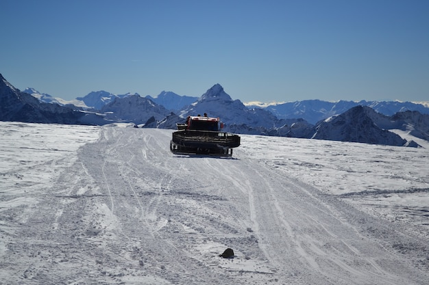 Snowplow in the mountains cleans the road from snow Premium Photo