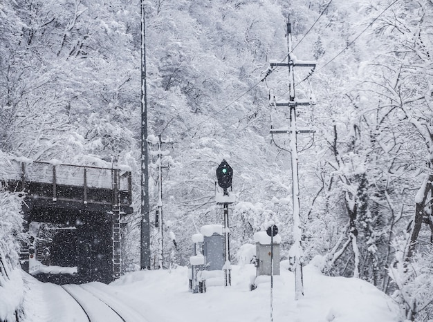 Snowstorm with and poor visibility on the railroad tracks. winter season in toyama city, japan.