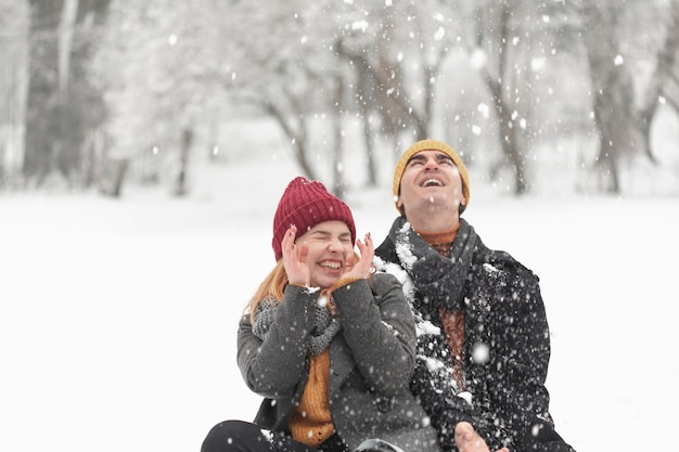 Snowy day and couple in the park