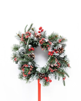 Snowy festive wreath on white background