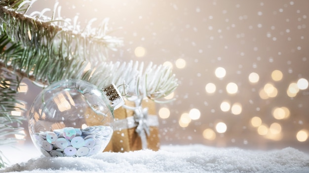 Snowy fir-tree branch with christmas lights bokeh