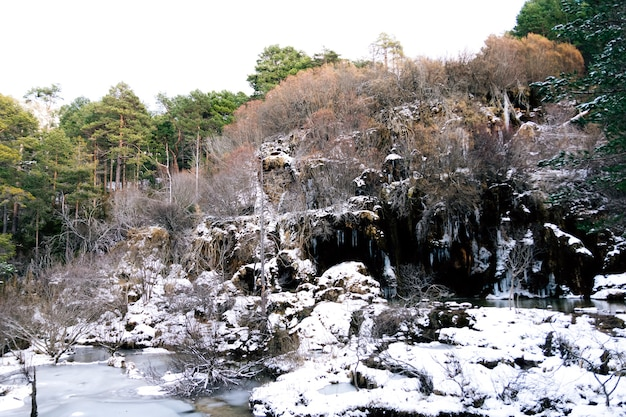 Snowy landscape of the source of the river cuervo in cuenca, spain.