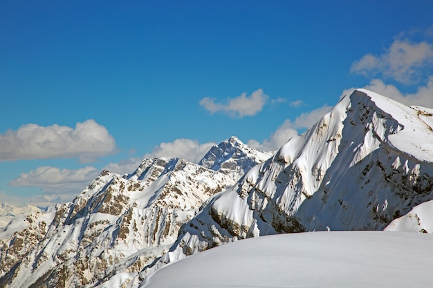 Snowy mountain peaks against the blue sky