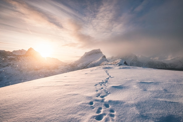 Snowy mountain ridge with footprint in blizzard
