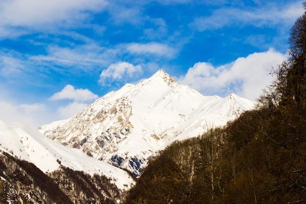 Snowy mountains landscape in gudauri, georgia. sunny day.