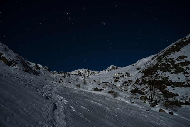 Snowy slopes illuminated by the moonlight