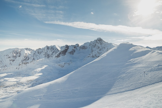 Snowy slopes in winter mountains. skiing resorts.