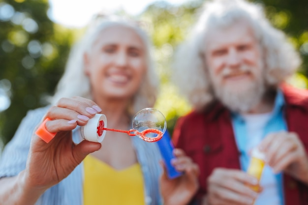 So beautiful. selective focus of a soap bubble being blown by joyful elderly people