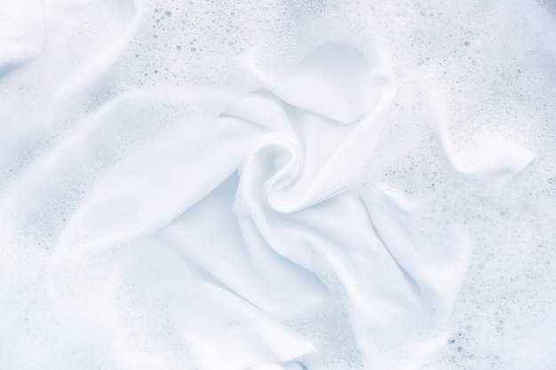 Soak a cloth before washing, white cloth.