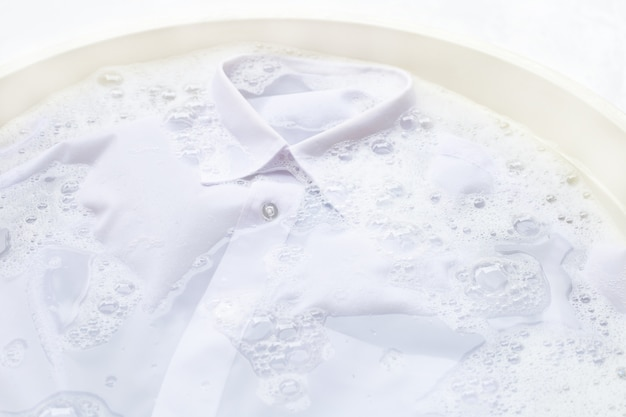 Soak  cloth before washing, white shirt