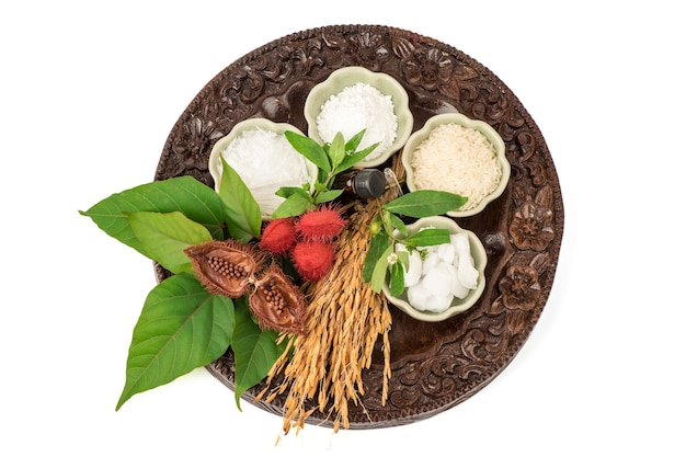 Soak hair with false daisy,bixa orellana,jasmine rice,menthol, camphor and borneol isolated on white background.top view,flat lay.