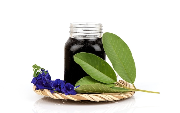 Soak hair with guava leaves and butterfly pea flowers isolated.