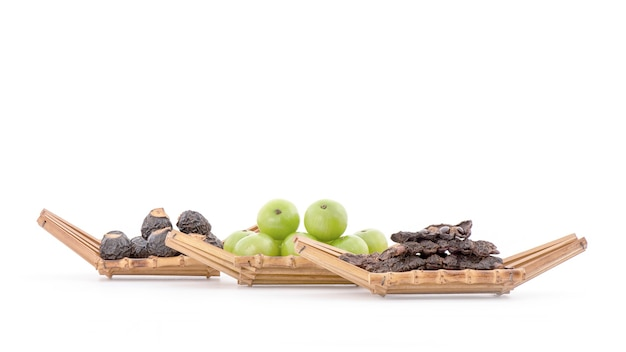 Soak hair with indian gooseberry ,soap nut tree and soap pod isolated on white.