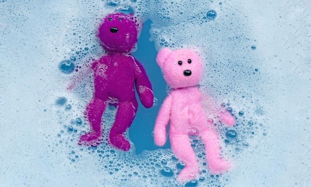 Soak toy teddy bear in laundry detergent water dissolution before washing.