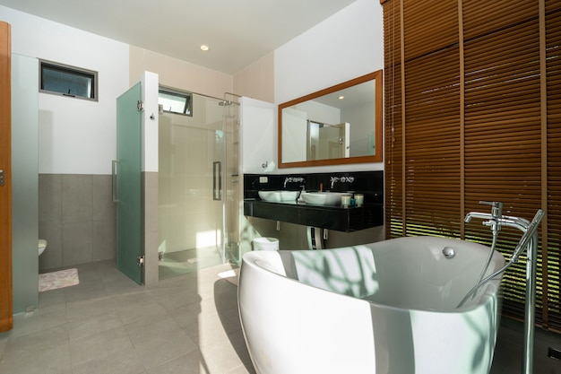 Soaking bathtub in modern bathroom