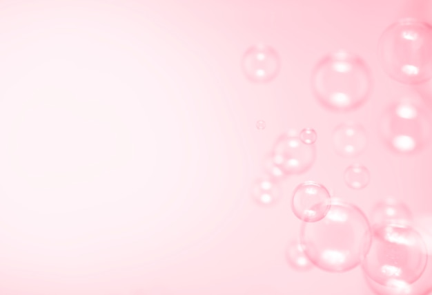 Soap bubbles on pink background