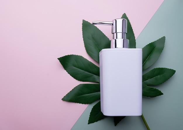 Soap dispenser on a green leaf