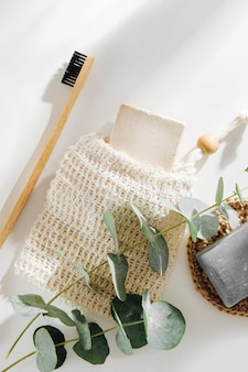 Soap eco bag, bamboo toothbrush, natural brush eco cosmetics products and tools. zero waste, plastic free. sustainable lifestyle concept.