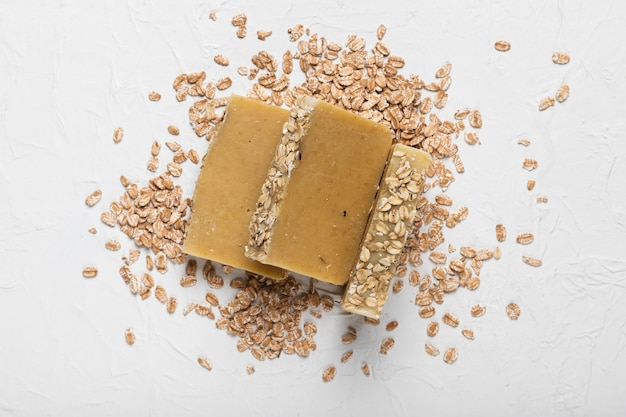 Soap with oatmeals around on table