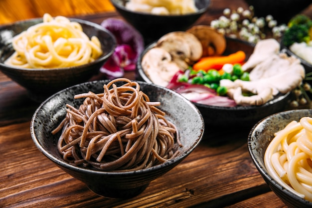 Soba japanese buckwheat noodles in a black bowl