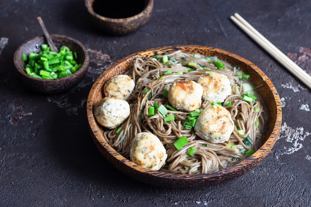 Soba noodles served with chicken meatballs and green onion.