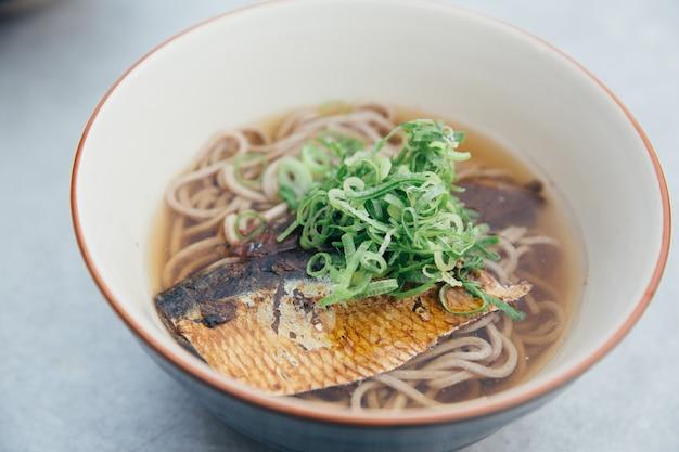 Soba noodles soup with mackerel