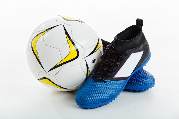 Soccer ball next to cleats