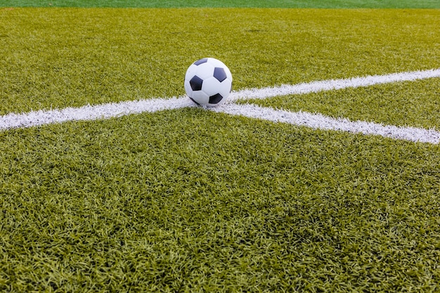 Soccer ball, football artificial grass with white stripe, football stadium
