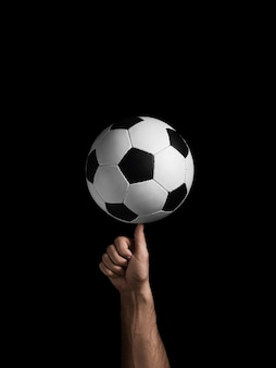 The soccer ball rotates on the finger