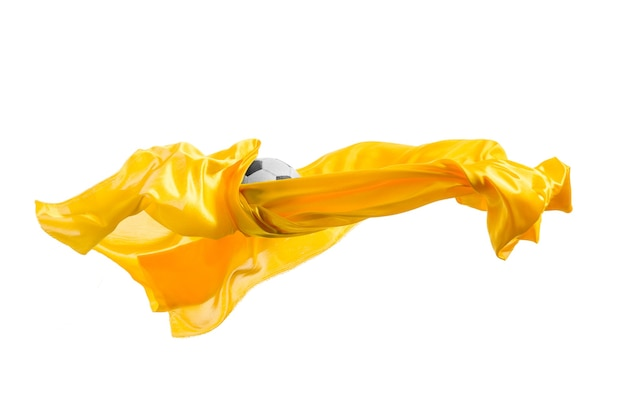 Soccer ball and smooth elegant transparent yellow cloth isolated or separated on white wall