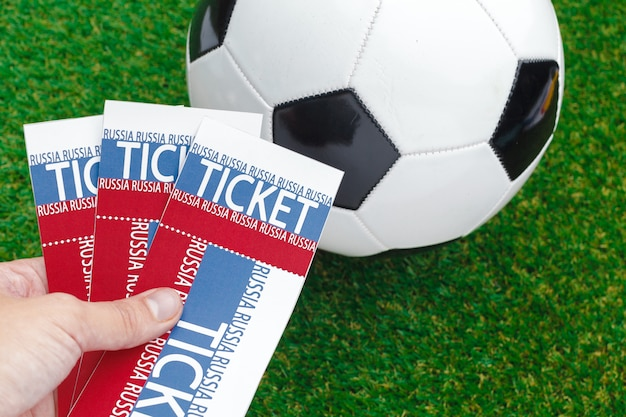 Soccer ball and tickets