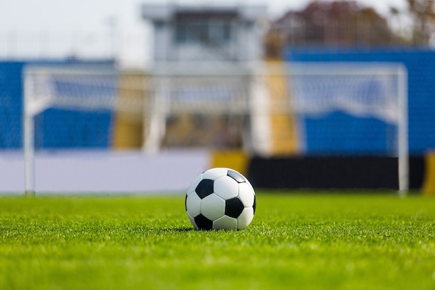 Soccer ball with goalpost on background