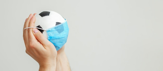 Soccer ball with a medical mask