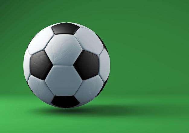 Футбольный мяч с тенями на зеленом