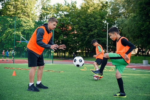 Soccer coach instructs teen players.
