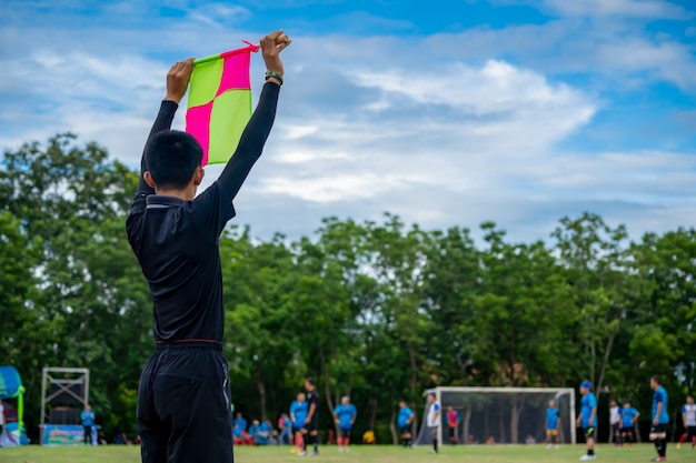 Soccer flag in hand of assistant referee soccer football