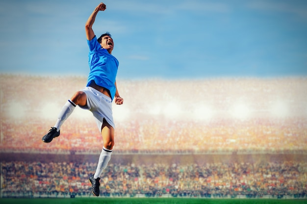 Soccer football player in blue team concept celebrating goal in the stadium during match