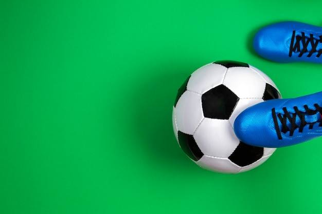 Soccer football player with soccer ball on green background