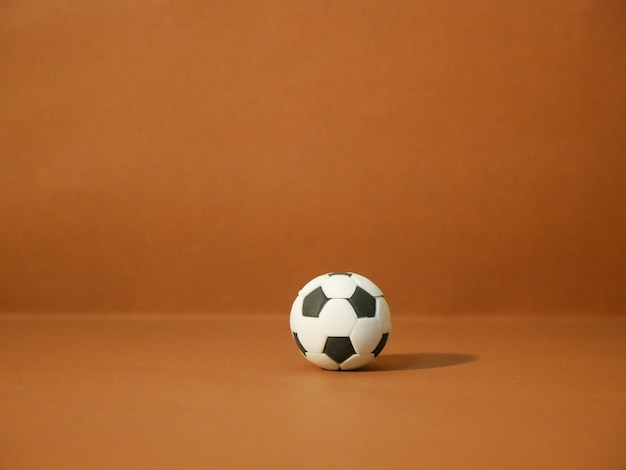 Soccer football with copy space on brown background