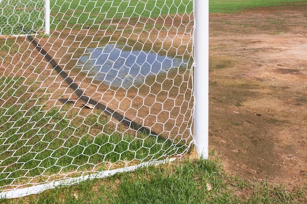 Soccer goal with grass field.