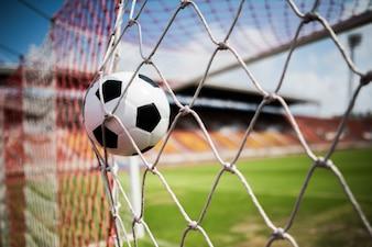 Soccer into goal success concept