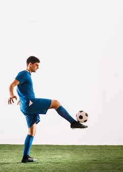 Soccer player balancing ball