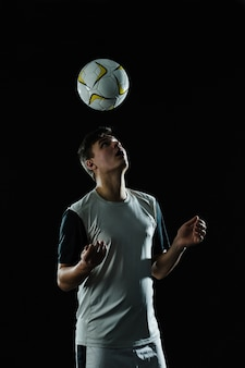 Soccer player hitting ball with head