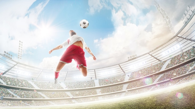 Soccer player jumping to hit a soccer ball with his chest