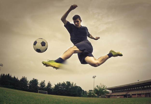 Soccer player kicking a ball