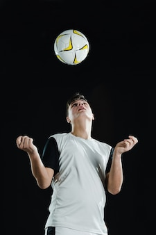 Soccer player playing ball with head