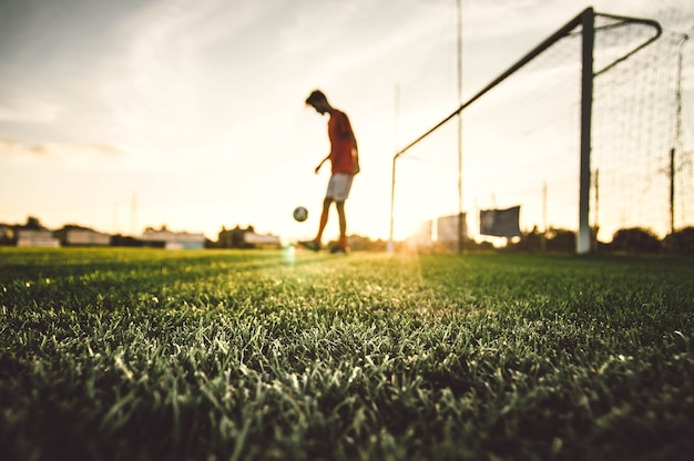 Soccer player playing football on stadium