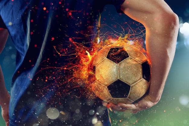 燃えるようなサッカーボールで遊ぶ準備ができているサッカー選手