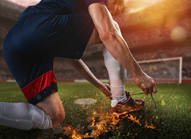 燃えるような靴を履いてプレーする準備ができているサッカー選手
