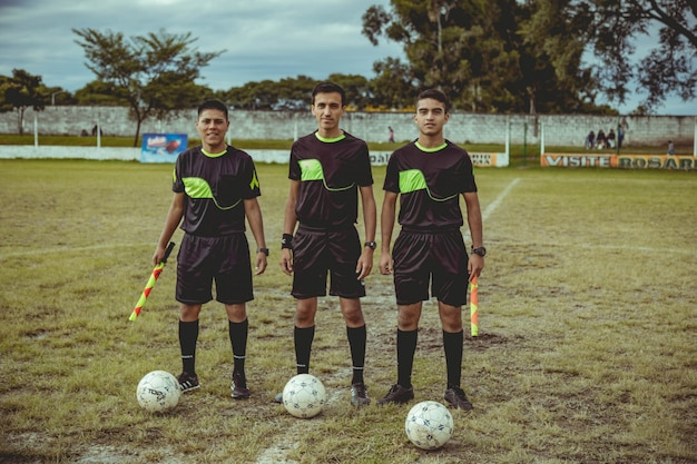 Soccer referees on the court